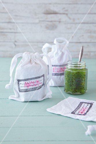 Fabric bags with names as gift wrap