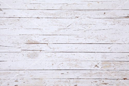 A surface of white-painted wooden boards