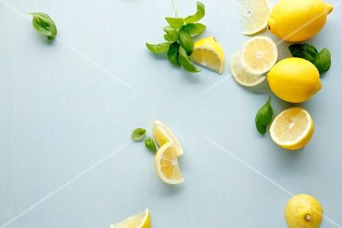 Fresh lemons and basil leaves