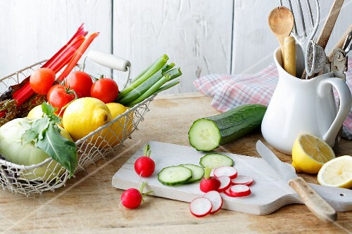 An arrangement of vegetables and lemons