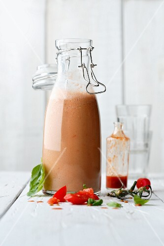 A tomato and basil smoothie made with buttermilk