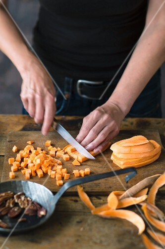 Sweet potatoes being diced