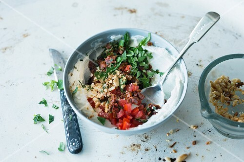 Goat's cheese and tomato spread with fresh basil and pine nuts