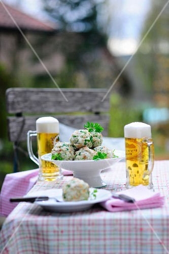 Breadcrumb dumplings and beer in a restaurant garden