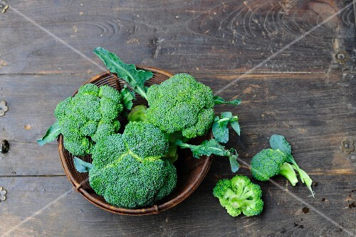 Broccoli in a bowl on a wooden surface