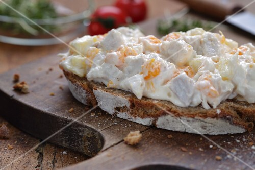 A slice of bread topped with chicken salad