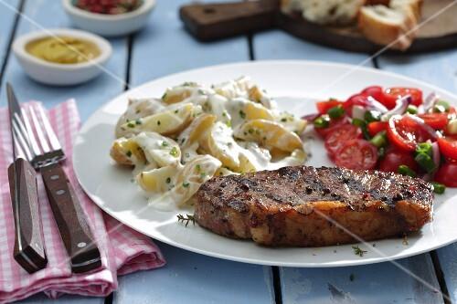 Rump steak with potato salad and tomato salad