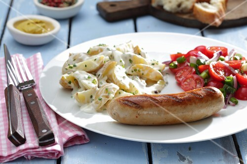 Sausages with potato salad and tomato salad