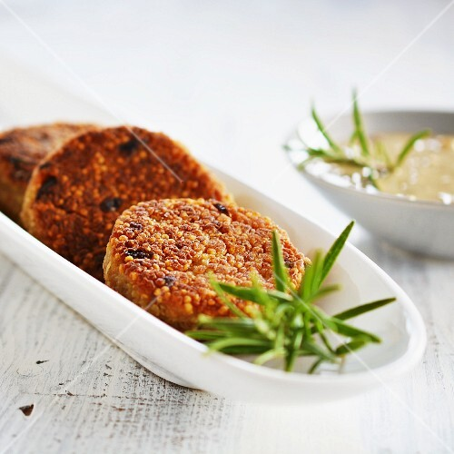 Quinoa cakes with a herb and mushroom sauce