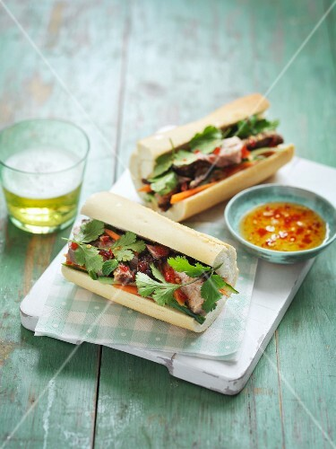 Baguette sandwiches with beef, coriander and chilli sauce