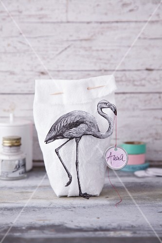 A fabric bag decorated with a flamingo print
