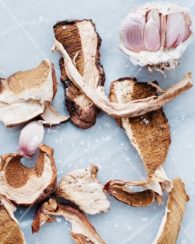 Dried, sliced porcini mushrooms and fresh garlic
