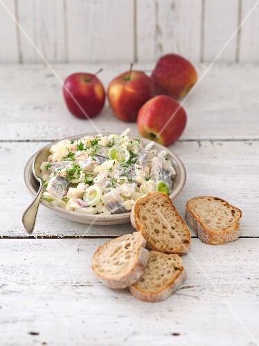Herring salad with apple, leek, onions and sour cream