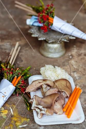 Sacrifices at a Buddhist shrine, Thailand