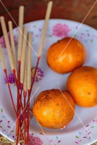 Oranges as a sacrifice (Thailand)