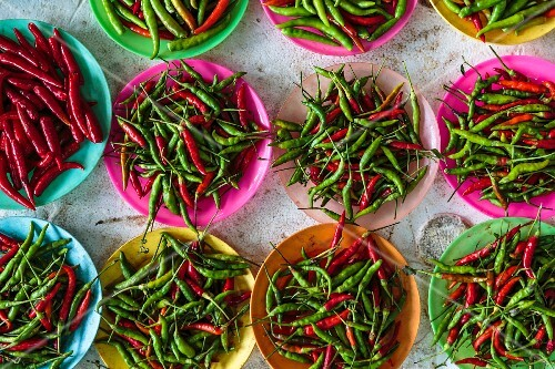 Bird's eye chilli peppers in bowls, Thailand
