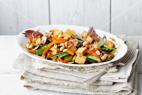 Stir-fried vegan vegetables with tofu and peanuts