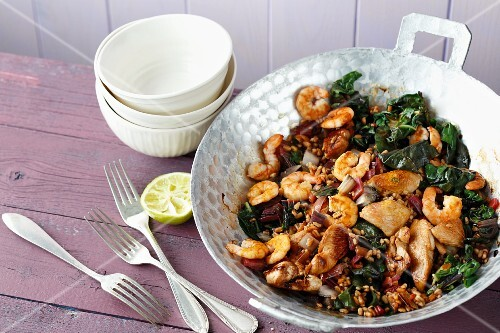 Quick chard and spelt stir fry with turkey escalope and shrimps