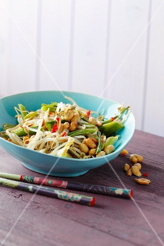 Fried mung bean sprouts with spring onions and peanuts