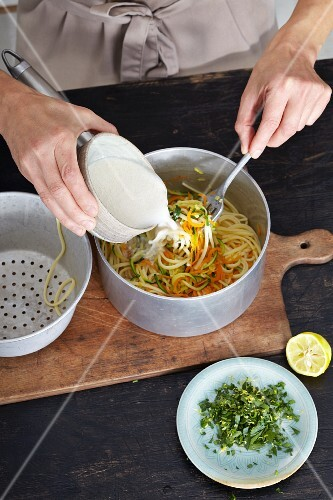 Vegetable noodles with tahini being made