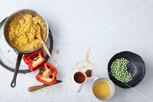 Vegetarian millet risotto with peppers, peas and ajvar being made