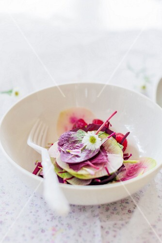 Purple spinach salad with watermelon and radishes