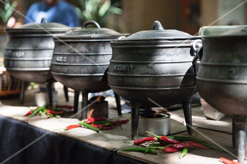 Cooking pots and chilli peppers at a market
