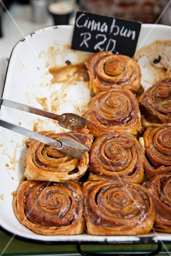 Cinnamon buns with a sugar glaze at a market