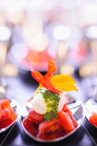 Tomato coulis with mozzarella, pesto and flower petals