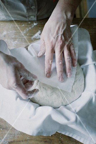 Bread dough being covered with a cloth