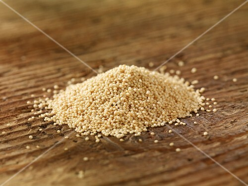 A pile of amaranth on a wooden surface