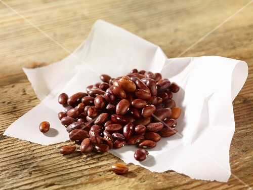 Borlotti beans on a piece of paper