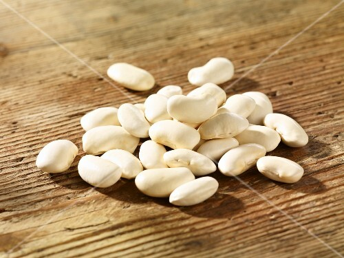 White beans on a wooden surface