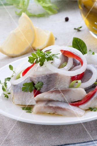 Herring salad with peppers, leek and onions