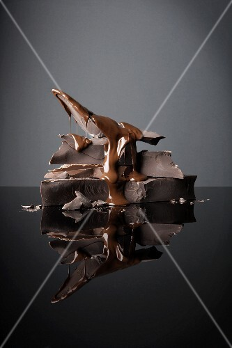 Pieces of chocolate and chocolate sauce