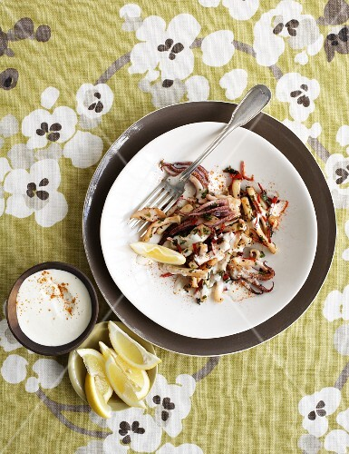 Squid with almond tarator and lemons