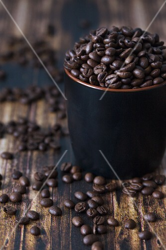 Coffee beans in a dark cup