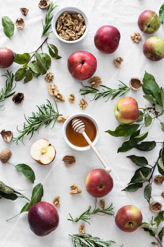 Apples, honey, walnuts and rosemary (ingredients for apple cake)