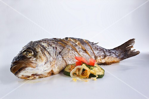 Fried catfish with a side of vegetables