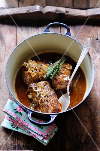 Braised beef ribs with onions and thyme
