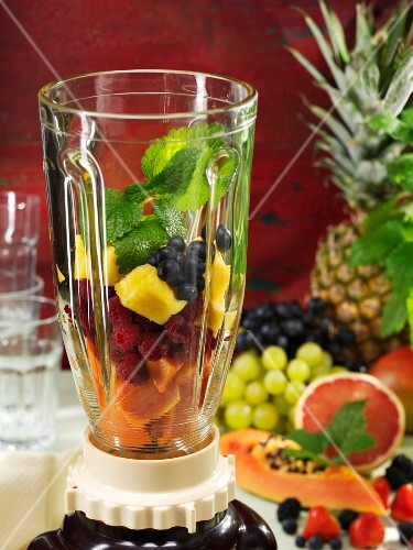 Ingredients for a fruity smoothie in a blender