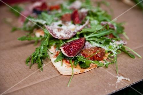 A fig, rocket and Parma ham pizza