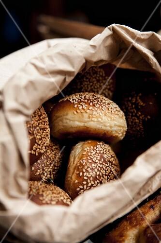 Sesame seed rolls in a bread bag