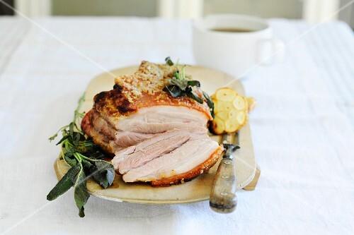 Roast pork with sage and garlic, sliced