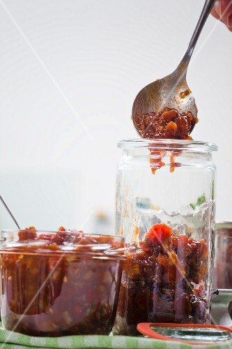 Vegan chutney made from dates and tamarinds being transferred into glasses