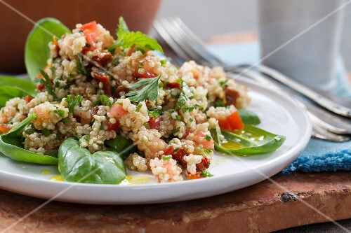 Vegan quinoa salad with tomatoes and fresh herbs