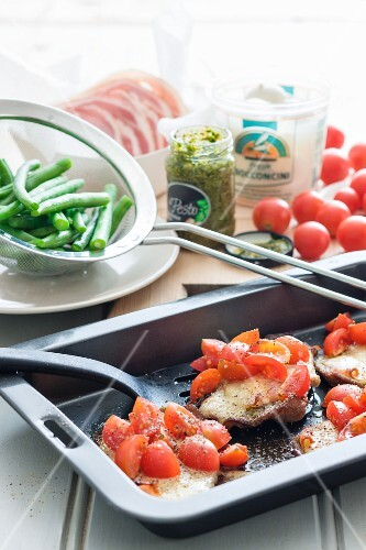 Minute steaks with tomatoes, basil and bocconcini