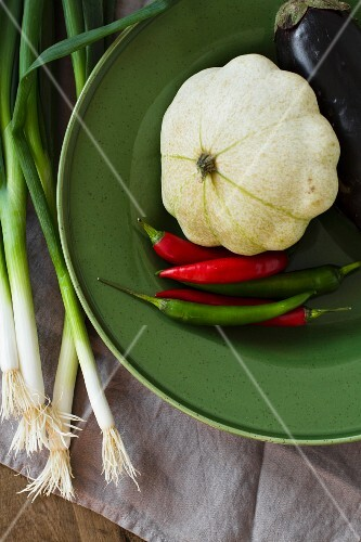 A pattypan squash, chilli peppers, aubergines and spring onions