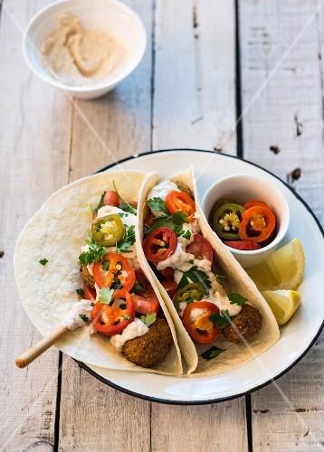 Tortilla with falafel, hummus and chillis