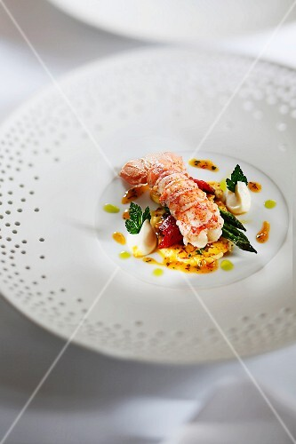 Sautéed langoustine on a bed of cauliflower in an orange and saffron reduction and parsley oil